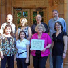 Dale Wymore (in pink shirt) and the Printing Services staff at California State University-Chico proudly displayed their FSC chain-of-custody certificate shortly after earning it last May.