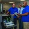 From left: Louis Lopez, Oscar Rivera and Jimmy Molina go over a job being finished on the Duplo System 5000.