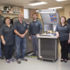The Columbia College Mail, Imaging and Printing Services team stands with the new Presstek 34DI-E offset press. From left: Ted Krause, Josh Wagner, Glenda Perry, Les Toalson, Dan Jimenez (director), Bethani Davis, Mark Tindell and Amy Brooks. Not pictured: Dieke Gosseen.
