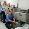 Standing with the Ricoh Pro C7100SX digital color press at California State University, Chico, are (from left) Ed Heeter, Kathleen Huber, Dale Wymore and Joe Hilsee.