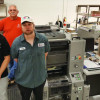 From left: Drew Burgering, George Sharp and Justin Wiese show off Valdosta State University Printing and Copying Services' new four-color Presstek 34DI direct imaging press.