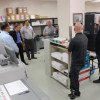 Visitors mingle by the new Ricoh in DMBA's in-plant during an IPMA meeting in November.