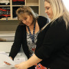 Tami Reese (left) and Communications Specialist Shauntel Gonzalez go over a proof in the Design & Print Center.