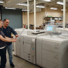 Kylie Dentremont (left) and Samual Graham check out a proof printed on the in-plant's Canon imagePRESS C800 production printer.