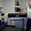 Bob Donahue, manager of Franklin University Mail & Print Services, shows off his in-plant's dye-sublimation equipment.