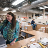 Debra Price, campus mail center manager, meters mail using a Pitney Bowes SendPro P3000.