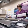 Jane Ciehoski, copy center supervisor, sets up a job on the HP DesignJet Z5400 wide-format printer.