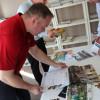 Nathan Thole examines entries.