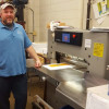 Operator Bill Peroni handles the majority of the work performed with the new Challenge 30.5˝ paper cutter installed at Mercer County Community College.
