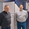Operators Todd Emel (left) and Don Wilson stand with the in-plant's Xerox iGen4 Diamond, the centerpiece of its digital print area.