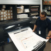 Victor Ramirez checks the output of a CTA Neighborhood Map produced on an HP DesignJet Z6100.