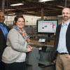 Amanda Loftus (center) operates the  Duplo DC-746 slitter/cutter/creaser. With her are Aji George (left) and Rob French.