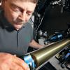 Mark Spicer checks a roller on the HP Indigo 10000.