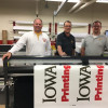 From left: Director Nathan Thole, Production Supervisor Steve Miller and Assistant Director Zach Covington proudly show off Iowa State University Printing and Copy Services' new 64˝ Graphtec FC8600-160 contour cutter.