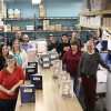 The DCMO BOCES print shop staff shows off some finished yearbooks and coil bound materials that they produced. Left side, front to back: Jeanette Sutton, Annette Bagnall-Graham, Heather Conklin, Frank Oliver and Kevin Beers. Right side, front to back: Bill Closs, Shelley Gibbons, Robbie Moore, Spencer Stone and Eric Moore.