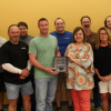 The staff of Frisco Independent School District's Print, Mail and Sign Center poses with their RSA Customer of the Year award.