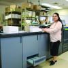 Sandra Climaco operates the in-plant's Konica Minolta bizhub PRO 1052 black-and-white printer.