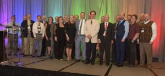 All Franklin Society members (which include CGCMs and Certified Mail Managers) in attendance at IPMA 2019 took to the stage to welcome Kelly Hogg and Christopher Donlon into their ranks.