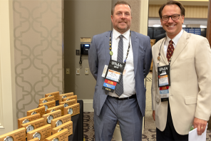 Kelly Hogg (left) and Christopher Donlon, the newest Certified Graphic Communications Managers, were honored during IPMA 2019.