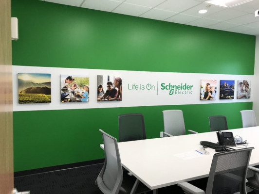 Sample of wide-format graphics installed by the in-plants at Schneider Electric.