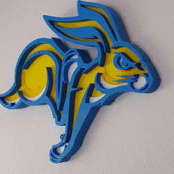 Measuring 24x18˝, these tiled South Dakota State University logos are printed on a MakerBot 3D printer, then colored acrylic is cut with a laser system and the two are put together to create the final piece.