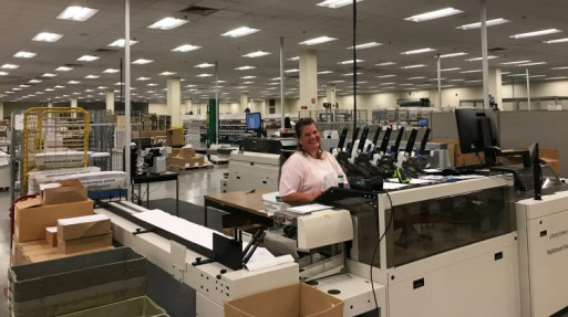 Danielle Gardner operates the Pitney Bowes Mailstream Evolution inserter inside PMM's spacious facility.