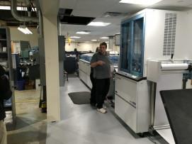 Installers setting up the Hunkeler paper-handling equipment.