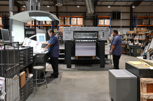 Working on the six-color, 40˝ Heidelberg Speedmaster press in the new facility are JP Correa (left), lead pressman, and Jose Cisneros, offset press assistant.