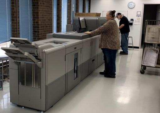 Mary Lowrey and Lee Hull operate the new Ricoh Pro C9200 digital color press.