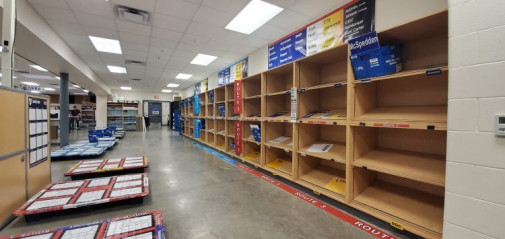 Materials printed for the district's 72 schools are sorted onto shelves where they are picked up by couriers for next-day delivery.