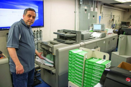Columbia Print switched to TreeZero paper, made from recycled sugarcane waste fiber, for all black-and-white jobs. Here, Daniel Romanello uses the paper to run a course pack for the Columbia Law School on the Ricoh Pro 8210.