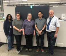 Staff of Omaha Public Schools Printing & Publications Services stand with their new Xerox Baltoro inkjet press.