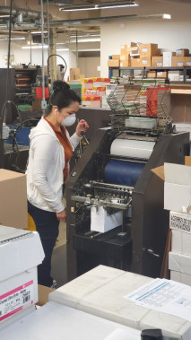 Sally Rodriguez prints envelopes on the AB Dick 9810 at Houston Independent School District Printing Services.