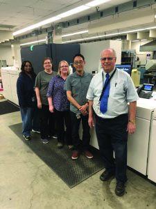 Standing with Omaha Public Schools' second inkjet press, a Xerox Baltoro, are (from left) Lynette Woods, Judy Lambert, Jody Clausen, Marc Peters, and Steve Priesman.