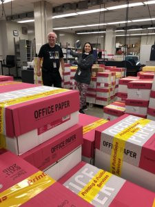 Steve Priesman, manager of Omaha Public Schools Printing & Publications Services, and Donna Dobson, director of elementary education, celebrate the completion of 24,000 student packets printed by the in-plant, ranging from 40 to 90 pages in length.