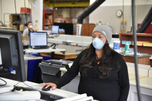 Oregon's state printing operation has been busier than ever during the pandemic. Here, Desiree Sutterlee prepares to print a production job.