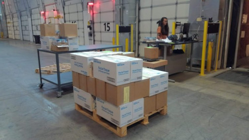 In the Wilsonville warehouse, Oregon Publishing & Distribution staff member Madison Evans processes UPS shipments of