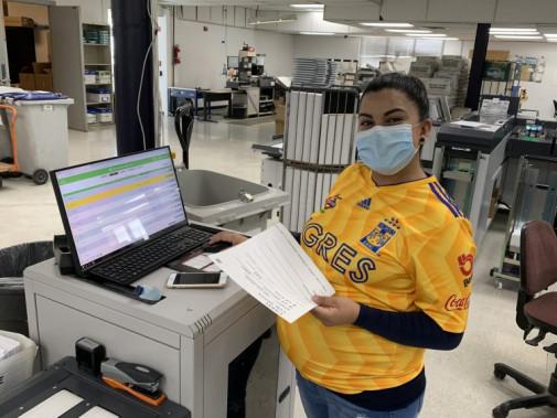 Cynthia Compean loads a Mail Run Data File (MRDF) into the inserter at Colorado's IDS operation.