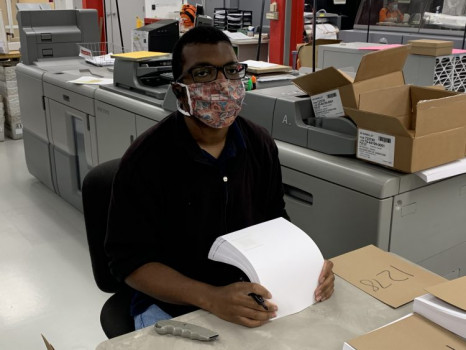 David Kimbrough does quality control on label stock at Colorado's Integrated Document Solutions operation.