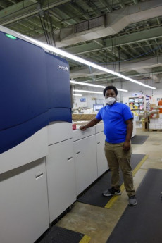 Anthony Jenkins prepares to print a mailer for incoming students on the Xerox iGen 5.