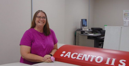 Office Support Supervisor Cindy Hohman shows off the in-plant's newly acquired Agfa Acento computer-to-plate system.