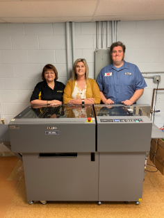 The new Duplo 646 slitter/cutter/creaser has not only eliminated toner cracking on folds at Wichita State University but has made business card slitting much more efficient. With it here are (from left) Ellen Abbey, Leah Lipke, and Ryan Kingsley.