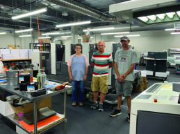 The in-plant's principal offset press is a four-color Shinohara 52 perfector, attended here by (from left) Connie Mayes, Obie Wolfe, and Shane Smith.