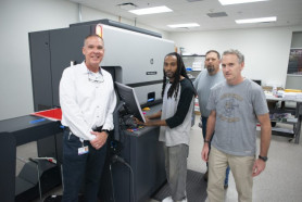 Powered by new HP Indigo 7900 and Xerox Iridesse digital presses, Print Services has stepped up the quality of its printing. From left: Danny Kirkland, Antonio White, Glenn Conway, and Wendell Rotenberry.