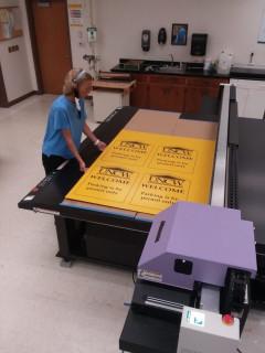 At SeaPrint Graphics Solutions, Heather Carter runs a job on the new Mimaki JFX200-2513 UV printer.