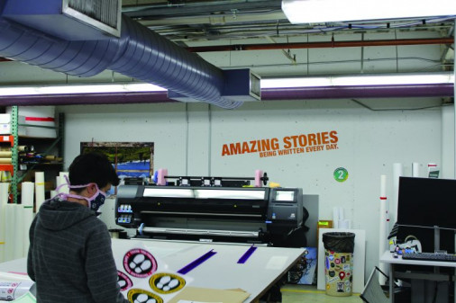 Kenna Bates checks social distancing adhesive floor graphics printed on the HP Latex 360 and contour cut on the Graphtec FC8600.
