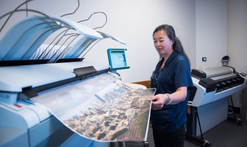 Lisa Gee prints a city view presentation poster for a meeting using the Canon ColorWave 500.