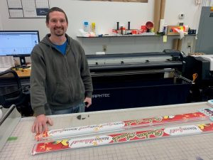 At Coborn's Inc. Print Services, Brian Dingmann creates removable clings for use in stores.