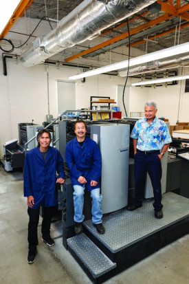The Reprographic Section of the Hawaii State Department of Education relies on its two-color Heidelberg Speedmaster perfector to serve 185,000 students in 250 public schools across the state's eight islands. From left: press operators Wilson Lam and Edwin Ho, and Administrator Jason Seto.