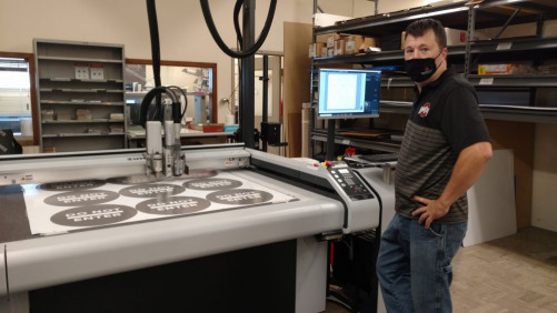 Brian Campbell cuts COVID-19 signage with the Zund S3 M-1200 digital cutter.